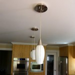 Three lighting fixtures in kitchen
